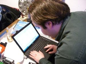 Man-on-laptop-Mecklenburg-DWI-Lawyer-Charlotte-Criminal-Attorney-300x225