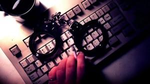 Cuffs on Keyboard Charlotte Criminal Attorney North Carolina Felony Lawyer