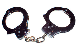 handcuffs-close-up-Charlotte-Criminal-Lawyer-Mecklenburg-DWI-Law-Firm-300x179