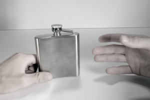 handing a flask Charlotte Criminal Lawyer Mecklenburg DWI Attorney