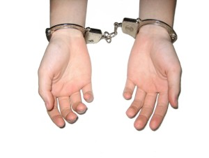 Handcuffed hands Charlotte Criminal Lawyer Mecklenburg Defense Attorney
