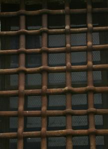 Prison-window-bars-Charlotte-Criminal-Defense-Lawyer-Mecklenburg-Attorney-217x300
