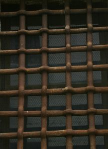 Rusted-bars-over-window-Charlotte-Criminal-Defense-Lawyer-217x300