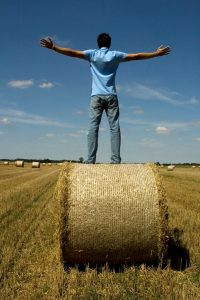 man-on-hay-bale-Charlotte-Mooresville-Expungement-Lawyer-200x300
