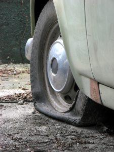flat-tire-Charlotte-Monroe-Lake-Norman-Criminal-Defense-Criminal-Attorney-225x300