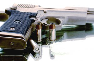 pistol-and-bullets-Charlotte-Monroe-Mooresville-gun-rights-attorney--300x196